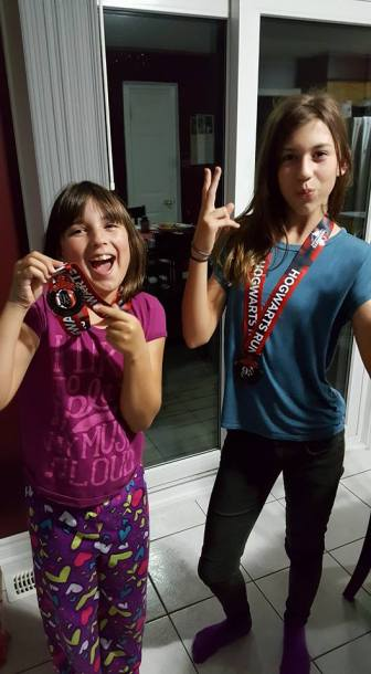 Proudly showing off their 9 3/4 K medals.